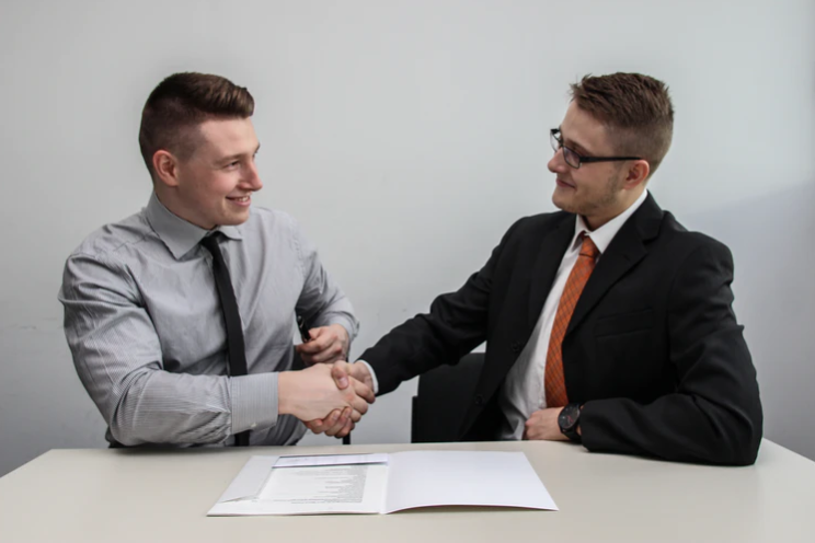 businessman shaking hands with a tax advisor